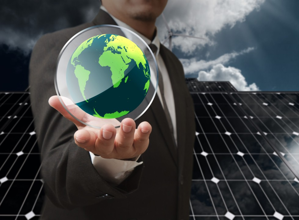business man hand show the earth glass shield as concept